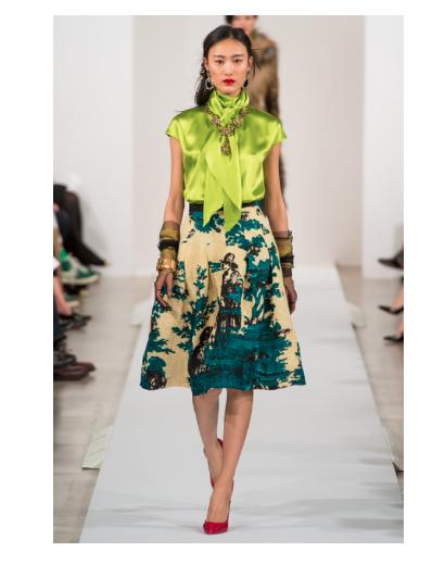 Oscar de la Renta accessorizes this joyfully green outfit at New York Fashion Week.